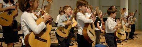 Kid Playing Classical Guitar